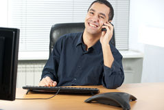 Businessman talking on telephone in office Royalty Free Stock Photography