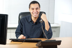 Businessman talking on telephone in office Stock Image