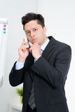 Businessman talking on telephone. In office Stock Photography