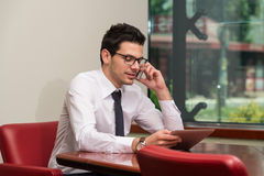 Businessman Talking On Telephone In Office Stock Images