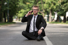 Businessman Talking On Telephone Outdoors In Park Royalty Free Stock Photos