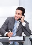 Businessman talking on telephone Stock Images