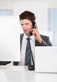 Businessman Talking On Telephone Royalty Free Stock Images