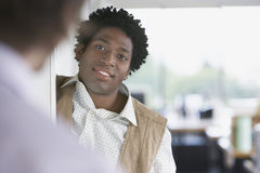 Businessman Talking To Blurred Colleague In Office Stock Photos