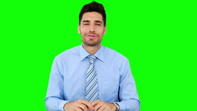 Businessman talking to the camera. On green screen background stock video
