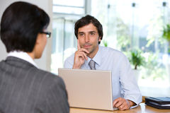 Businessman talking to client Royalty Free Stock Photography