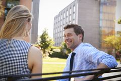 Businessman Talking To Female Colleague On Break In Park royalty free stock photo