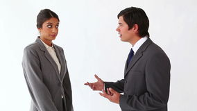 Businessman talking to her secretary. Against a white background stock video