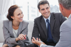 Businessman talking to his partners. In cosy meeting room Royalty Free Stock Photo