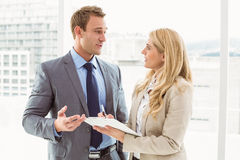 Businessman talking to his secretary Royalty Free Stock Image