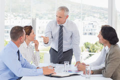 Businessman talking to his team Royalty Free Stock Photo