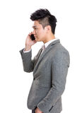 Businessman talking to mobile Stock Photography