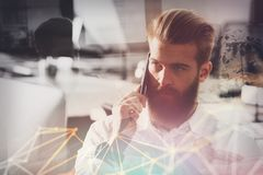 Businessman talking to the phone in office Stock Image