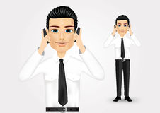 Businessman talking on two cell phones Royalty Free Stock Images