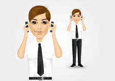 Businessman talking on two cell phones Stock Photography