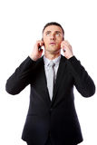 Businessman talking on two cell phones at the same time Stock Photography