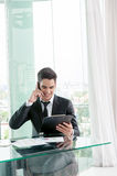 Businessman talking via cell phone Stock Photography