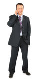 Businessman talks by cell phone Royalty Free Stock Images