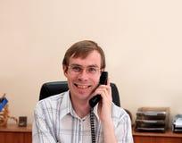 Businessman talks on a phone Stock Image