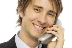 Businessman talks on phone. Businessman in a suit uses a corded telephone Royalty Free Stock Images