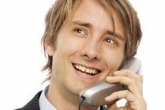 Businessman talks on phone Stock Photo