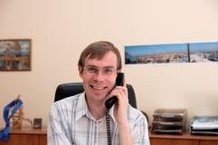 Businessman talks on a phone Royalty Free Stock Photo
