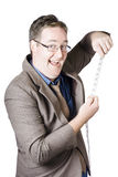 Businessman with tape measure on white background Royalty Free Stock Photos