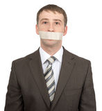 Businessman with tape over his mouth Royalty Free Stock Photos