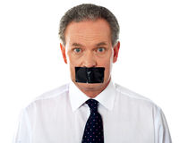 Businessman with taped mouth Stock Image