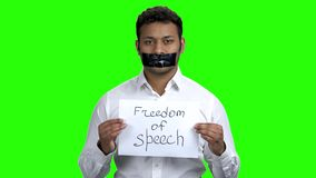 Businessman with taped mouth on Chroma Key background. stock footage