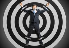 Businessman is taped to the target with adhesive tape.  royalty free stock images