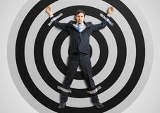 Businessman is taped to the target with adhesive tape.  stock photo