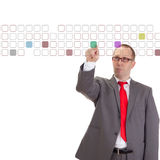 Businessman taping on some buttons. Businessman taping on some coloured buttons Royalty Free Stock Image