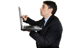 Businessman tapping his laptop Stock Photography