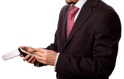Businessman tapping on a pda. Computer (isolated on white stock photo