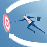 Businessman and target. Business concept success and goal, businessman with a sword hits the center of the target, employee with a rapier flies  to the target Stock Images
