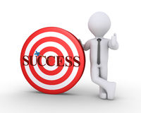 Businessman and target with success word on it. Businessman standing next to a target with success written on it and an arrow at the center Royalty Free Stock Photos