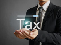 Businessman tax in  hand Stock Images