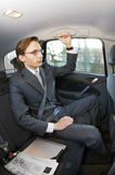 Businessman in a taxi Royalty Free Stock Image
