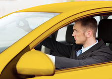 Businessman or taxi driver driving a car Stock Photo