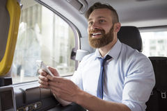 Businessman in taxi Royalty Free Stock Images