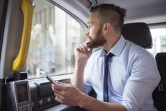 Businessman in taxi Stock Images