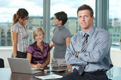 Businessman with team. Confident businessman at office with business team in background Stock Photos