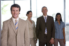 Businessman with team Stock Image