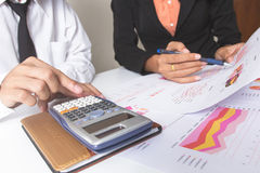 Businessman or Team discussing the charts and graphs showing the results of their successful teamwork.Financial reports are set of. Documents prepared by an stock photos