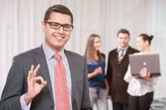 Businessman with a team at the meeting stock images