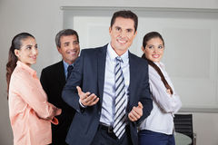 Businessman with team in office Royalty Free Stock Photo