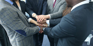 Businessman team in suit touching hands together. Selective focus. Stock Images