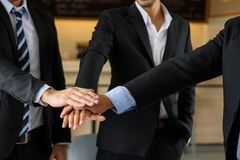 Businessman team touching hands, teamwork. Group of businessman team touching hands together after getting agreement on project.  symbol of teamwork at coffee Stock Image