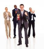 Businessman team winning. Smart businessman and team winning a trophy royalty free stock photo